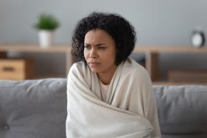 woman smelling something bad in her home