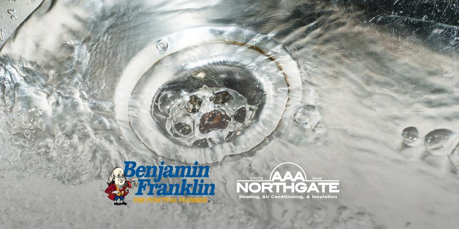 Plumbing services, sink draining water. Ben Franklin AAA Northgate partnership