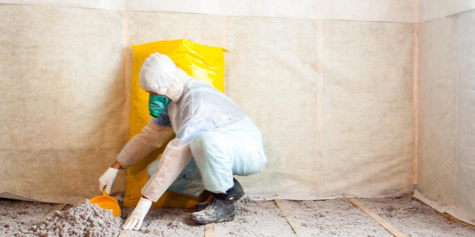 worker installing cellulose insulation