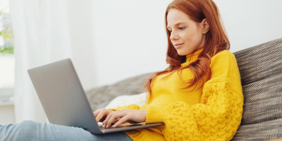 woman on laptop at home surfing the internet
