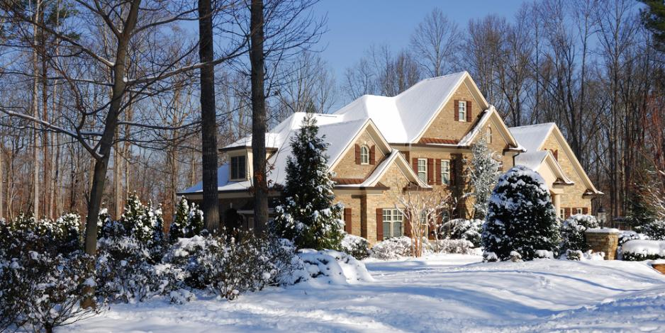 three-story house covered in snow